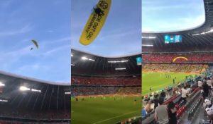 環保團體綠色和平組織乘滑翔翼衝入歐國盃場中抗議,未料竟失控造成2人受傷。圖:翻攝自推特